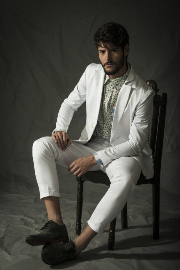Portrait photograph of a NYC white suit model